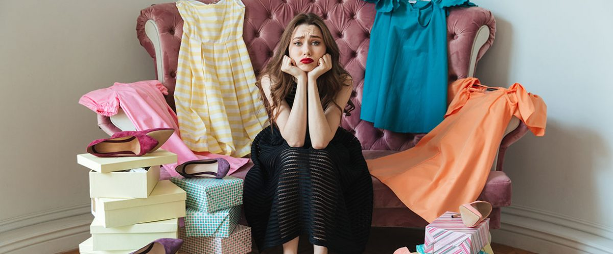 Woman surrounded by clothes