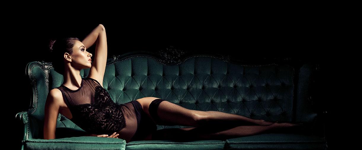Woman laying on sofa